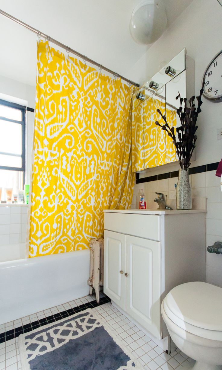 the yellow shower curtain brightens up this bathroom