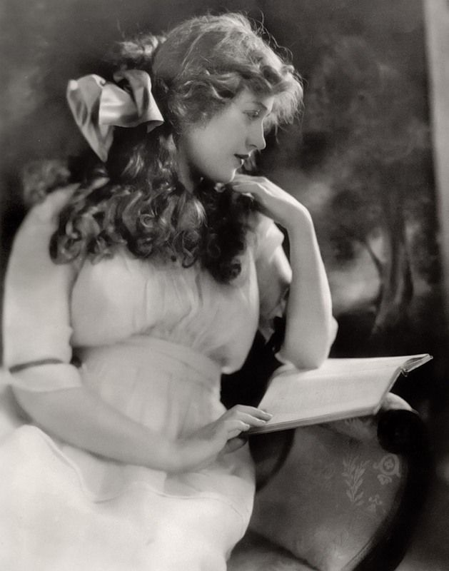 Marion Davies reads in publicity still, 1920′s.Davies (1897–1961) was already building a reputation as a popular film comedienne when newspaper tycoon William Randolph Hearst, with whom she began a relationship, took over management of her career. Hearst promoted her heavily, and pressured studios to cast her in historical dramas to which she was not suited. For this reason, Davies is better remembered today as Hearst's mistress and hostess at many lavish Hollywood events than for her…