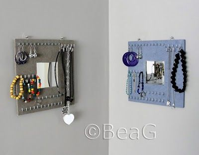 Okay, this is a good idea for jewelry using a recycled Ikea mirror - just screw different sized hooks into it