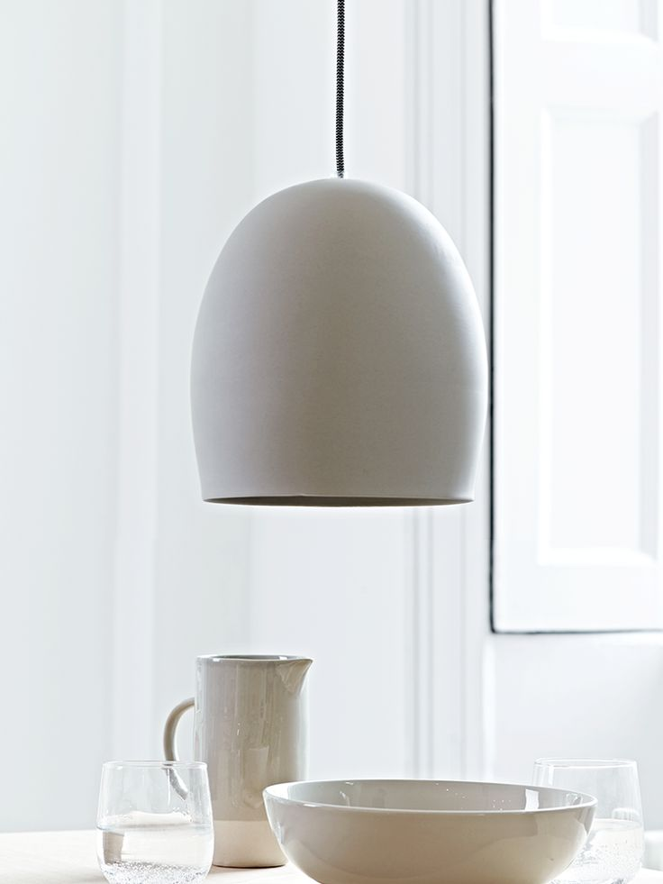 Beautifully cast from ceramic in a smooth oval shape, this simply designed pendant has a rustic unvarnished finish that looks just like concrete. With a traditional black and white woven flex and matching ceiling rose, this ceramic pendant adds cool contemporary style to your home. Click here to view our useful lighting buying guide, andtake a look at our blogfor ideas on how incorporate lighting into your home.