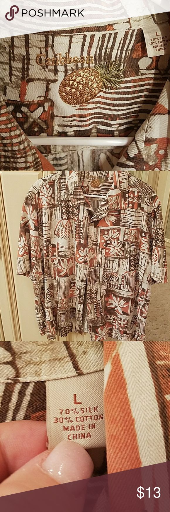 Men's short sleeve tropical button down Men's short sleeve button down is 70% silk. Very soft and super comfy! No stains. Good condition Caribbean Shirts Casual Button Down Shirts