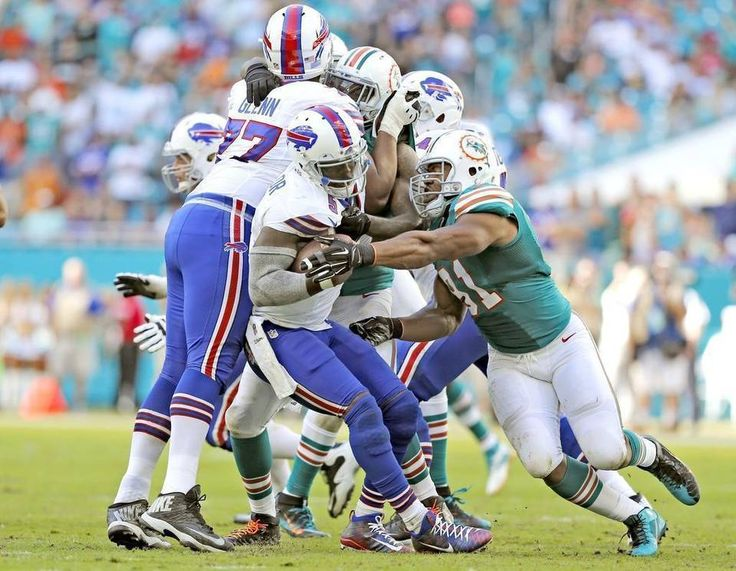 Bills vs. Dolphins:    October 23, 2016  -  28-25, Dolphins  -      Buffalo Bills quarterback Tyrod Taylor (5) is sacked by Miami Dolphins defensive end Cameron Wake (91) in the fourth quarter as the Miami Dolphins host the Buffalo Bills at Hard Rock Stadium on Sunday, October 23, 2016.  AL DIAZ adiaz@miamiherald.com