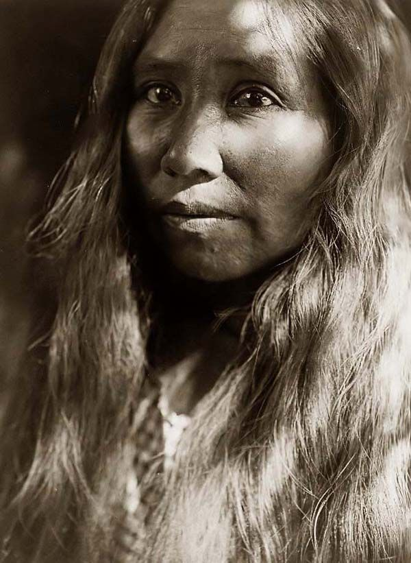 Above we show a moving photo of a Kato Woman. It was made in 1924 by Edward S. Curtis.    The illustration documents a Kato Indian in a head-and-shoulders portrait, facing left.