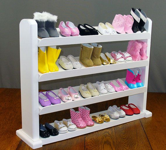 Our large shoe rack is perfect for displaying and organizing your shoes and boots for your 18 inch Doll. It easily accommodates 24 pair of shoes and boots. Our doll furniture is handcrafted of solid hardwood and is completely assembled. We do not use soft wood such as pine. The doll clothes rack has been painted with several coats of white enamel paint for a long lasting finish  It measures approximately 25 left to right, 6 front to back and 18.5 tall. The top 3 shoe shelves are 4.5 wide and…