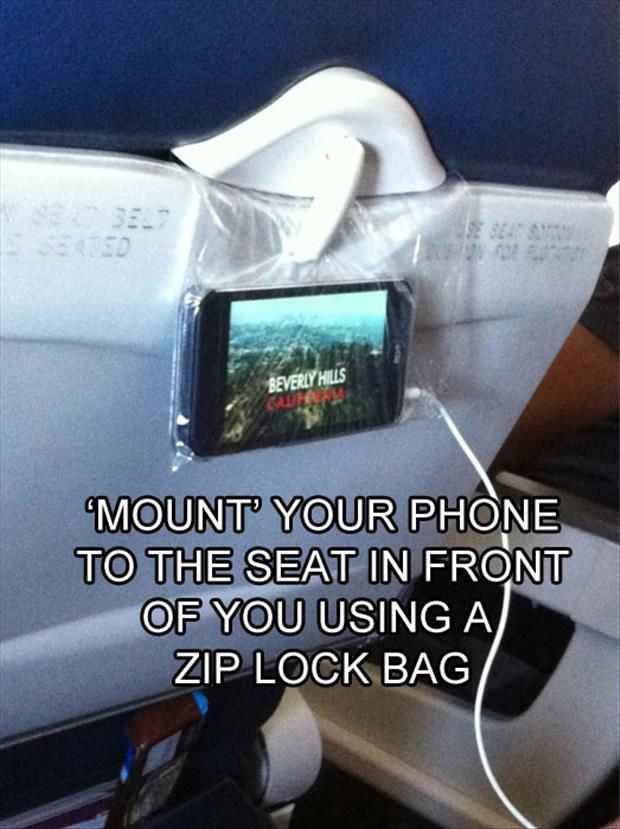 Mount your phone to the seat in front of you on the plane using a ziplock bag