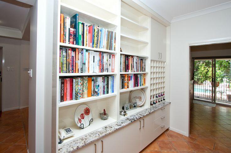 Every kitchen should have a bookcase and wine rack! www.onecallkitchens.com.au