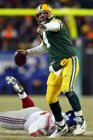 Brett Favre Photos Photos - Quarterback Brett Favre #4 of the Green Bay Packers throws the ball during the NFC championship game against the New York Giants on January 20, 2008 at Lambeau Field in Green Bay, Wisconsin. The Giants defeated the Packers 23-20 in overtime to advance to the Superbowl XLII. - NFC Championship: New York Giants v Green Bay Packers