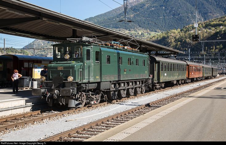 Fast train electrolocomotive Ae 4/7 # 10976 from 1931 with a contemporary passenger train ready for departure in Brig, Switzerland.