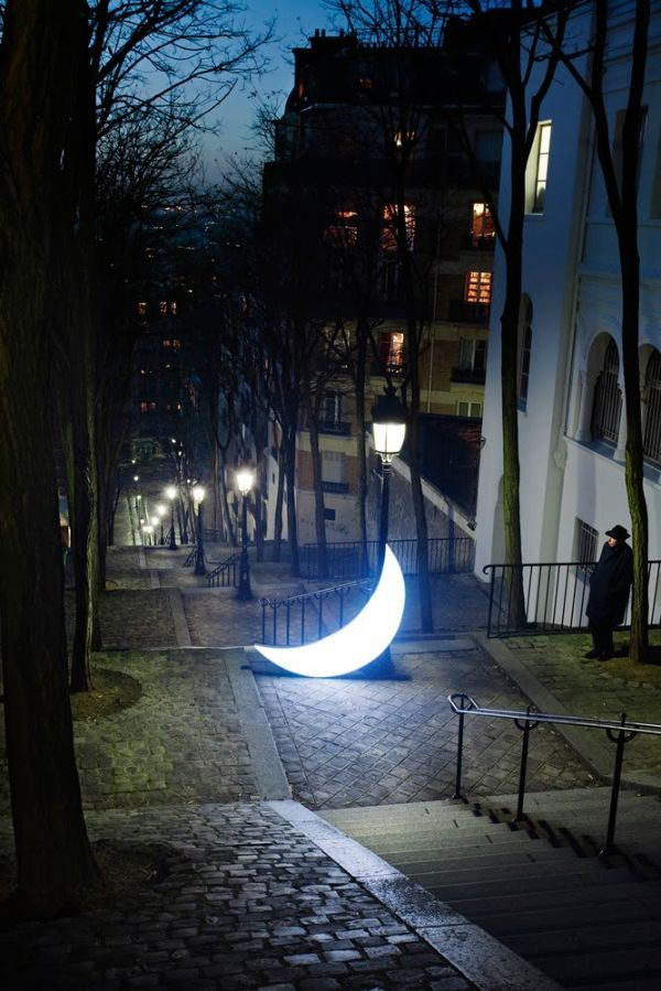 Russian artists Leonid Tishkov and Boris Bendikov created a fantastic world illuminated with the moonlight where they tried to convey relations between the man and the Moon. This is a romantic story about a man who met the Moon and decided to stay with it forever. They named the installation 'Private Moon'.