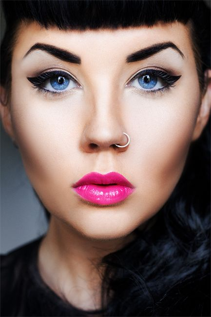 Lovely updated retro inspired look with bright pink lips defined eyebrows and thick bold winged liner with the nose ring!