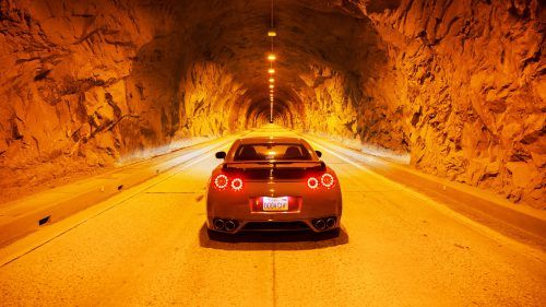 This picture of Nissan GTR in the tunnel is a perfect background for sports car lovers. It's a high resolution picture of Nissan GTR in rear view, the lighting of the tunnel could create a dramatic effect. The picture was taken in a perfect angle with symmetric position. The result is a perfect photo of Nissan GTR in 4K Ultra HD resolution.