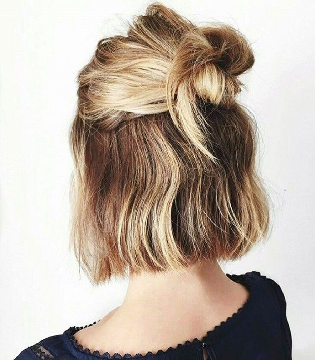 Whether long or short, pulling your hair into a half bun is an easy way to cure the rainy-weather-hair blues. Add a few spritzes of Ouai Texturizing Hair Spray ($26) for a little extra...