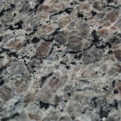New Caledonia Description of Caledonia Granite-The Primary color of this granite is brown with varying shades of whites and grays creating an overall look of charcoal to light gray. This very consistent granite is also known as Ocre Itabira and Silver Brown.