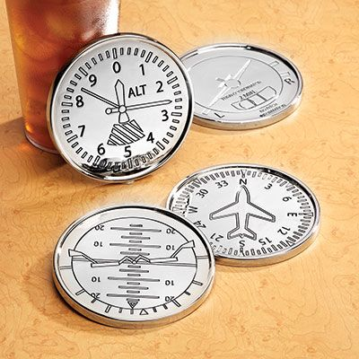 """Classic Instrument Coasters (Set of 4) Nickel Plated These Classic Instrument Coasters resemble instruments from classic aircraft composed onto nickel plated coasters. Each set is complete with Altimeter, Attitude Indicator, Directional Gyro, and Turn & Slip Indicator. To prevent sliding, they feature a soft, durable black felt backing. Coasters are about 3.25"""" in dia."""