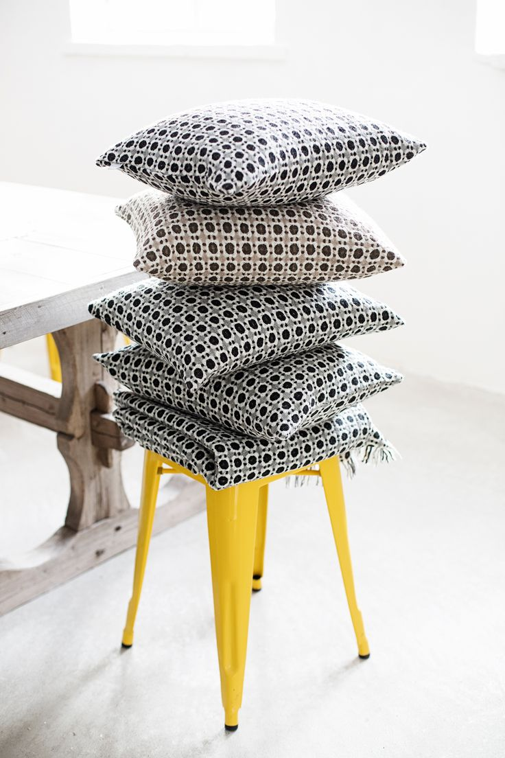 CORONA pillows and throw in 100% wool. Design by Marja Rautiainen, woven in Finland by Lapuan Kankurit.