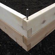 Raised garden beds...metal pins set securely through the ends of each board