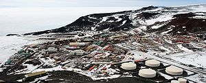 The McMurdo Station is a US Antarctic research center on the south tip of Ross Island, which is in the New Zealand-claimed Ross Dependency on the shore of McMurdo Sound in Antarctica. Photo shows McMurdo Station from Observation Hill. Wikipedia.