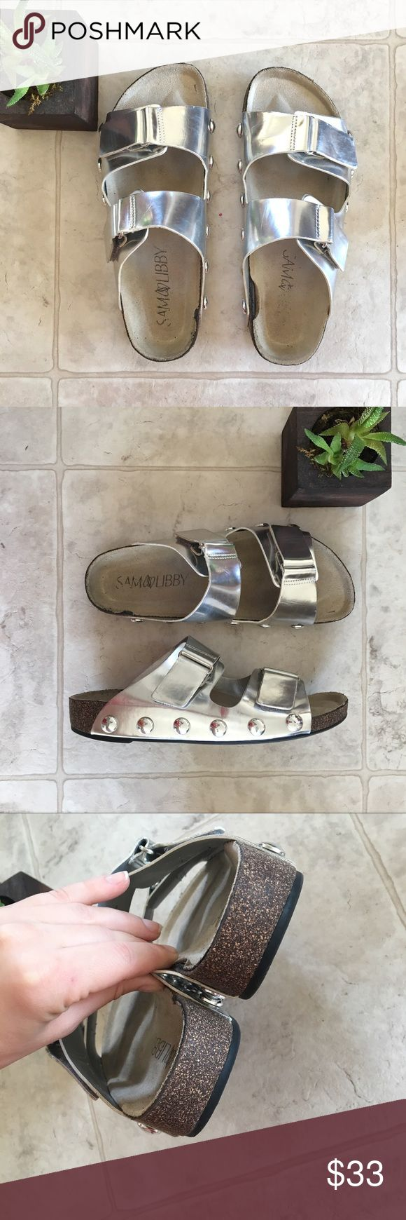 Silver Metallic Buckle Sandals, Slip-on Cork Shoes Beautiful silver sandals! Shiny metallic appearance. Birkenstock type shoe but brand is Sam & Libby. Cork and rubber soles that are super comfy yet sturdy. Velcro straps for adjustable tightness. Women's Size 7. Some very light wear as shown but overall really great shoes! Birkenstock Shoes Sandals