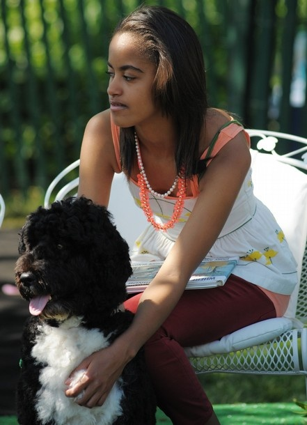 Malia Obama, oldest daughter of U.S. President Barack and First Lady Michelle Obama, with family pet Portuguese Water Dog Bo.
