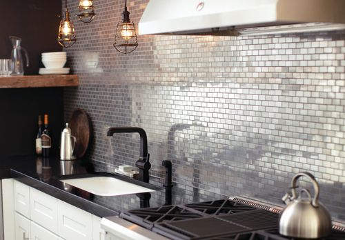 designmeetstyle:  Vintage industrial. Add shine and sophistication with an urban edge to your kitchen. Incorporate this style with bold details, like metal mosaic tile and cage pendant lighting. Get the look.