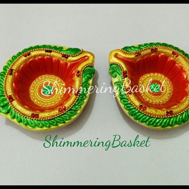 Designer diyas #green #orange #gold #kundan #rhinestones #handpainted #candlestand #tealightholders #candles #homedecor #indianfestivals #diwali #weddingdecor #craft