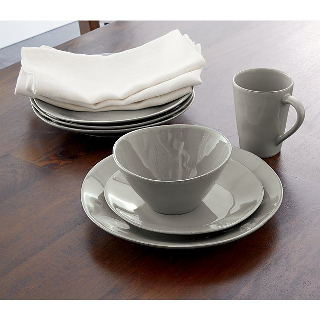 From Portugal, this artisanal dinner plate is crafted of stoneware and glazed a beautiful dove grey with subtle hand-antiquing on the freeform rim. This collection's soft, organic shapes bring a warm and welcoming feel to everyday and occasion dining.Marin dinnerware is available in a rich variety of colors.