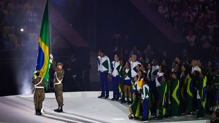 Rio de Janeiro's Environmental Police Command members raise the Brazilian flag during the opening ceremonies for the Rio 2016 Summer Olympic Games at Maracana.     -  Olympics: Opening Ceremonies