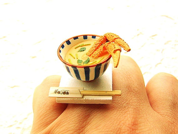 How cute is this?! There is a blue and white striped bowl and inside is miso soup with crab legs!   It is on a silver tone adjustable band that will fit most ring sizes. It measures about 3 cm wide.  SouZouCreations' products are made with attention to detail, creativity and long lasting dependability.