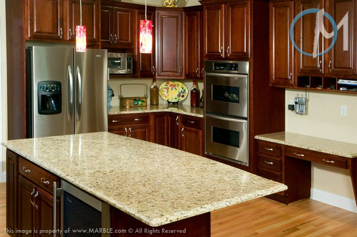 The Rich Cherry Cabinetry Contrasts The Honey Highlights
