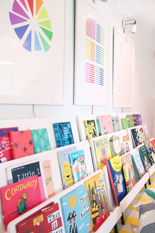 Create a colorful book nook in a child's room or playroom using forward facing bookshelves for easy access | Pencil Shavings