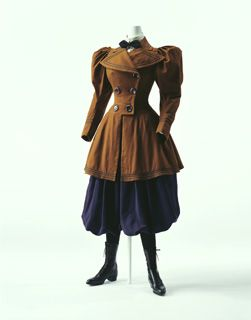 """A bloomer suit, an outfit for use with bicycles is created in the 1880s as special clothing for women to wear while riding a bicycle. Originally bloomers were loose, baggy, """"Turkish trousers"""", recommended for women by Mrs. Amelia Jenks Bloomer who oriented the women's emancipation movement, in the early 1850s. """"Bloomers"""" were generally rejected and treated with ridicule. Though pants-style clothing had not yet won approval, when women began participating in sports at the end of the 19th…"""
