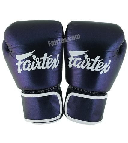Fairtex AURA MUAY THAI BOXING GLOVES Aura BGV12 Muay Thai Boxing gloves Aura gloves feature a pearlescent purple/blue color with a unique glow in the dark Fairtex Logo. These gloves are designed slightly different than the BVG1 gloves. They have a different shape and feature a grip bar for a [...]