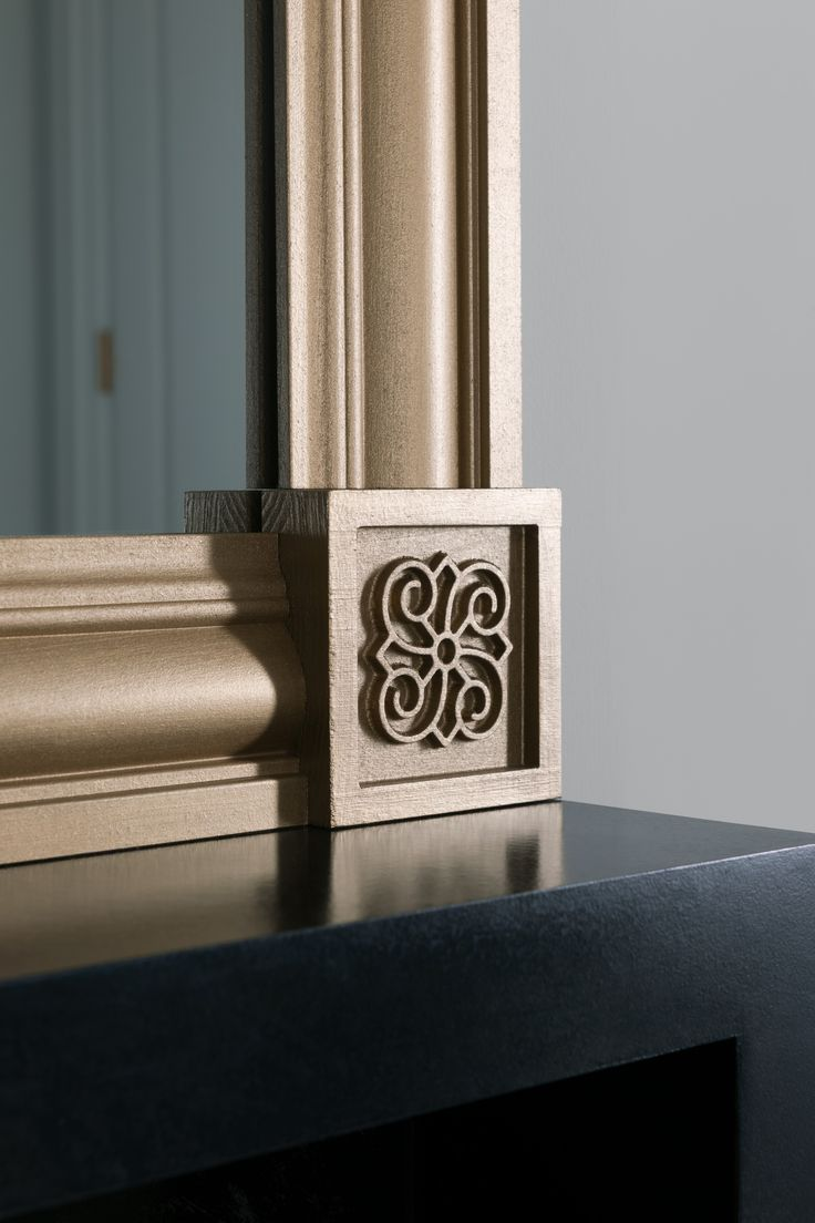 The Metrie Fashion Forward Collection Ikon is a new take on the classic #rosette. Here it is used to create a custom #mirror. The Fashion Forward Collection of #mouldings and interior #doors is representative of a transitional style. #trim #trimwork