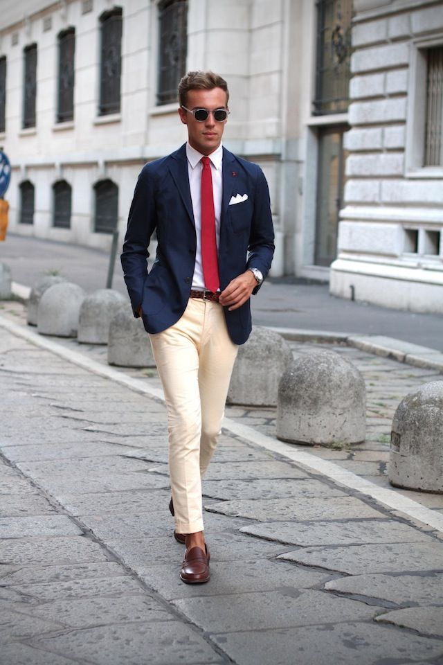 Shop this look on Lookastic: http://lookastic.com/men/looks/pocket-square-and-dress-shirt-and-tie-and-belt-and-blazer-and-dress-pants-and-loafers/3797 — White Pocket Square — White Dress Shirt — Red Tie — Dark Brown Leather Belt — Navy Blazer — Beige Dress Pants — Dark Brown Leather Loafers