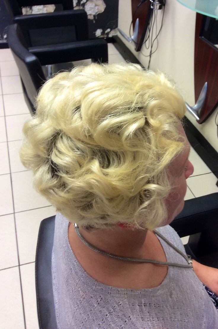 Finger-waves backcombed into short hair for a night out