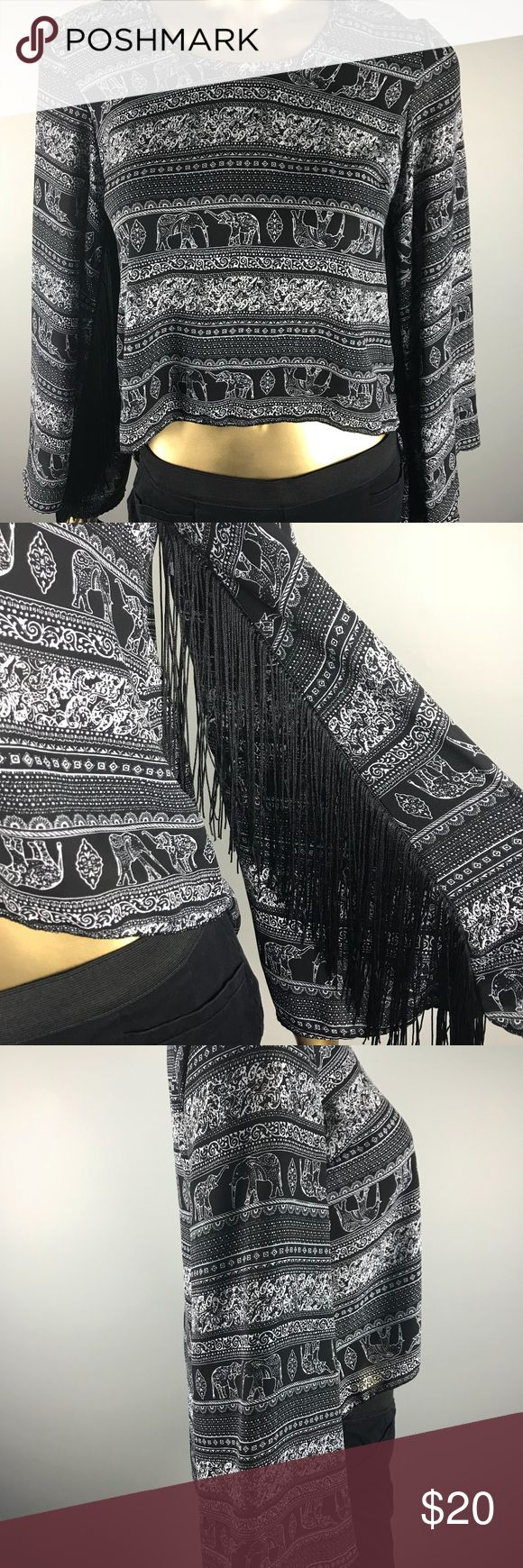 See You Monday Elephant Boho Crop Top Fringes, S Brand: See you monday Color: Black and white Style: Beautiful unique crop top with bat wing arm sleeves. Sleeves include fun fringes along the side, making this top totally boho! Perfect for a summer concert or spring break! Size: Small See You Monday Tops Crop Tops
