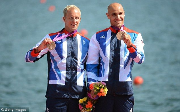 Flying the flag: The British pair pick up their bronze medal after the final Olympic event at Eton Dorney