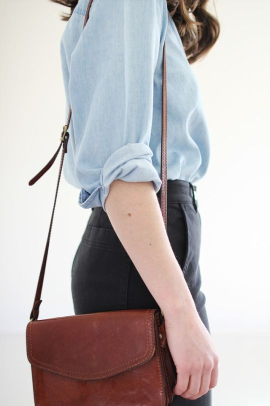 Blue blouse, high waist trousers, brown leather shoulder bag