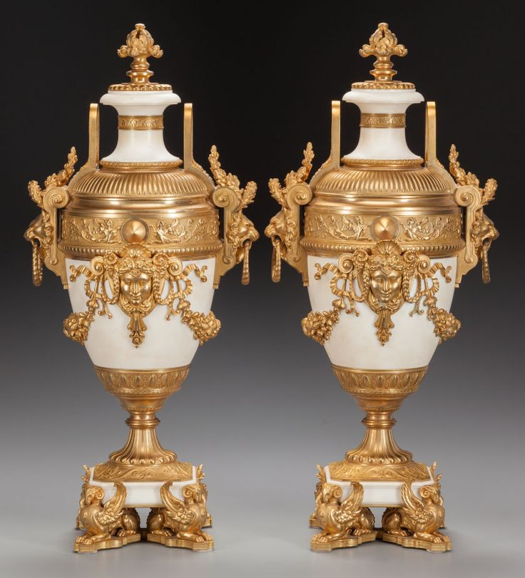 A PAIR OF LOUIS XVI-STYLE WHITE MARBLE URNS WITH GILT BRONZE MOUNTS, early-20th century.