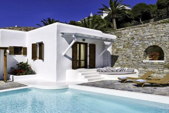 Situated in lush gardens overlooking Ornos Bay, our Mykonos #Villa Crystal with its magnificent #pool just waiting for you to dive into it.