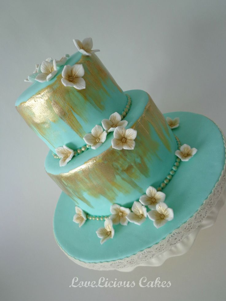Teal And Gold Cake With White And Gold Sugar Flowers