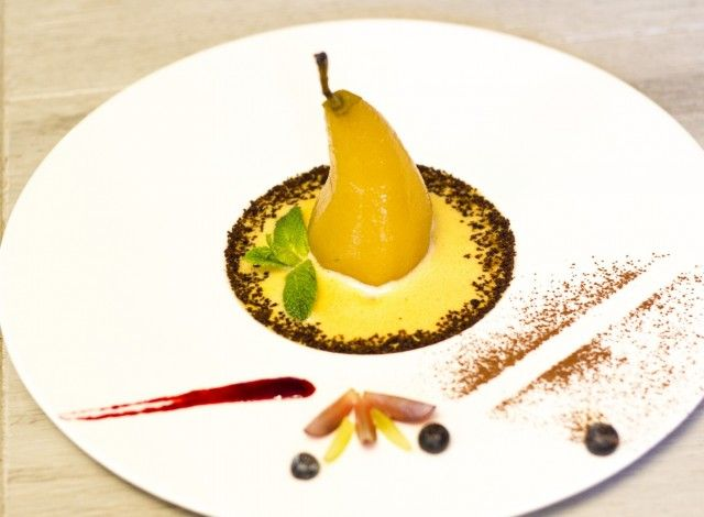"""Chardonnay poached Bosc pear with white wine and vanilla sabayone: Soft and crunchy at the same time, moderately sweet, it make a perfect combination with zabaglione-based sauce with brandy and sparkling wine. Delicate """"chocolate earth"""" sprinkling make this delicious dessert complete, also visually. In combination with black coffee, it has a truly poetic flavour. #Expo2015"""