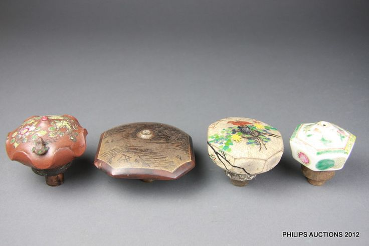 A group of four Chinese ceramic opium pipe bowls, latter half 19th century, one in porcelain, the others stoneware, including one yixing, va...