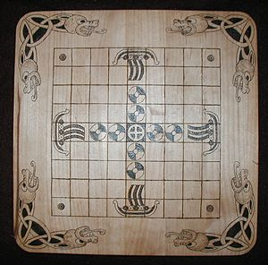 A Tafl board.  Burned, not carved.  I don't know how to play Tafl.