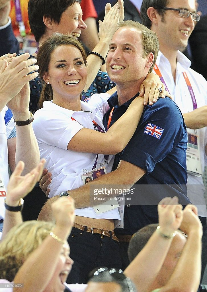 Catherine, Duchess of Cambridge and Prince William, Duke of Cambridge embrace after Philip Hindes, Jason Kenny and Sir Chris Hoy of Great Britain win the gold and a new world record in the Men's Team Sprint Track Cycling final during Day 6 of the London 2012 Olympic Games at Velodrome on August 2, 2012 in London, England.