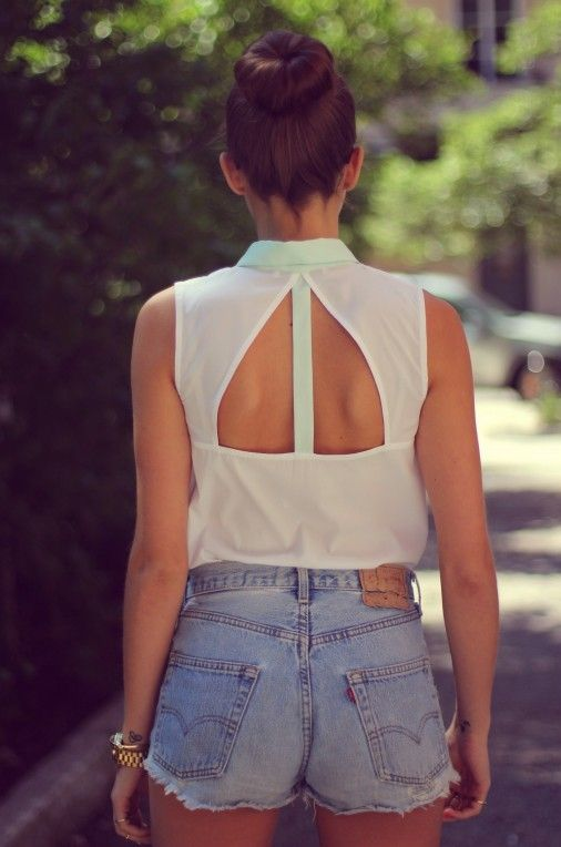 Love the back of that shirt, not so much the high waisted cut off jean shorts