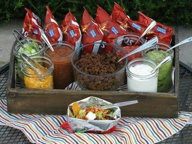 Portable taco bar! Great for camping trips or family get togethers. Crush the doritos in the bag & add your toppings and enjoy!