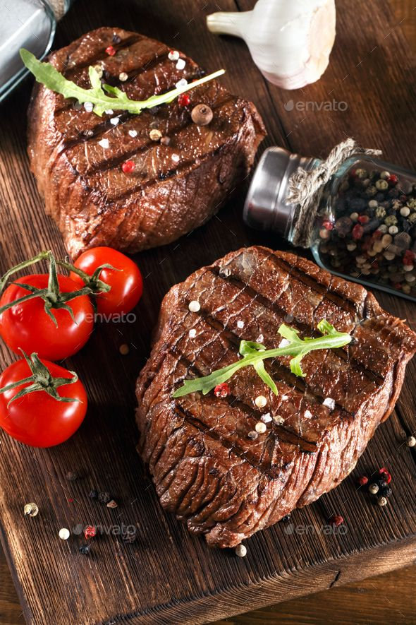 Beef Steak On A Barbecue Grill By Primo Piano Beef Steak On A Barbecue Grill With Vegetables Barbecue Steak Beef Gri Steak Beef Steak Tasty Steak Recipe