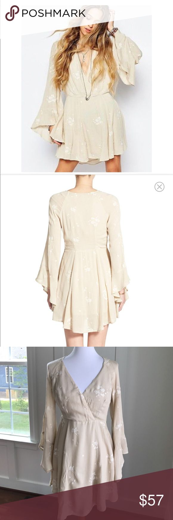 Free People Jasmine Embroidered Wrap Front Dress 4 Sweet floral embroidery punctuates the soft silhouette of a romantic wrap-front dress featuring flouncy angel sleeves and a gently flowing skirt. Like new condition. Free People Dresses