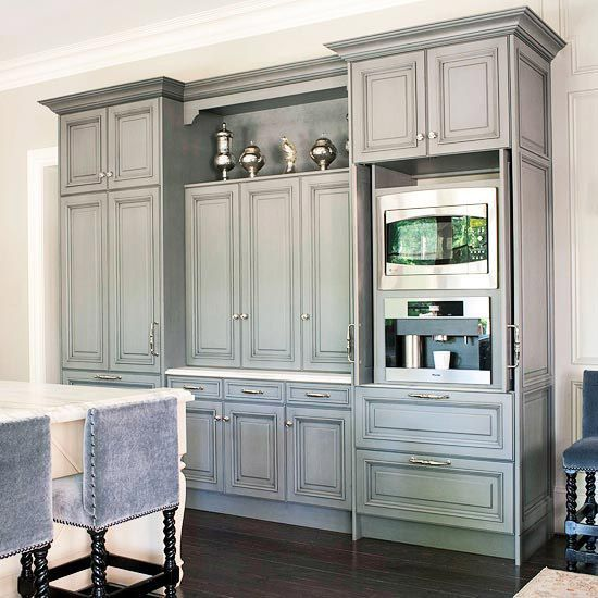 wall of gray cabinets + built in coffeemaker + mohair covered barstools